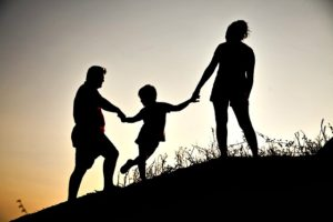 Family Shadows with a child to demonstrate Human Capital Value